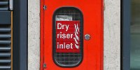 Dry riser inlet box for firefighters